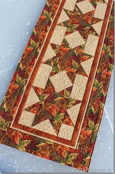 Autumn Table Runner - so pretty! I like the colors of this, but maybe pumpkins or sunflowers instead of stars. Patchwork Table Runner, Table Runner And Placemats, Table Runner Pattern, Quilted Table Runners, Fall Table Runner, Thanksgiving Table Runner, Fall Sewing, Place Mats Quilted, Autumn Table
