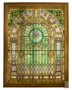 """This rare and beautiful stained glass window was made by the famous Rudy Bros. Co. at the turn of the century. J. Horace Rudy has been referred to as """"-- an artist to rival the likes of Tiffany and LaFarge."""" This magnificent window contains stained, beveled, and chunk jeweled glass."""