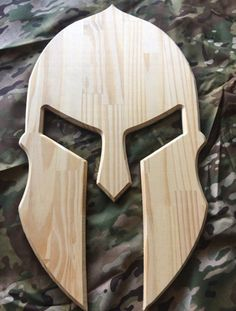 Wooden Spartan Helmet Plain Spartan Helmet design out of pine wood. Approximate size: x Easy to hang with a sawtooth picture hanger on the back. Can also add custom engraving or design Wood Shop Projects, Small Wood Projects, Woodworking Projects Diy, Woodworking Patterns, Woodworking Jointer, Woodworking Apron, Woodworking Logo, Woodworking Magazine, Woodworking Techniques