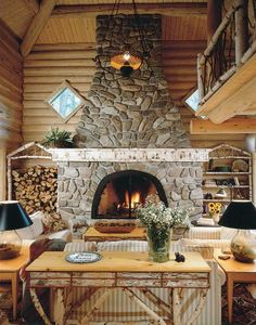 Massive stone fireplace. Love the log holder on the left and the matching shelves on the right!
