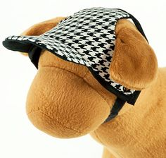 Houndstooth B & W Dog Hat  Timeless & classic black & white Corduroy Houndstooth hat.  The hat has self-adhering Velcro at neck that can be cut to fit the circumference of your dog's head. Hat shown is plain but can be personalized (7 letters maximum).   Perfect for any fashion savy pup!  Hat is reversible and machine washable.  Sizes XXS to large. Custom sizes also available upon request. Handmade in the USA.  Machine washable.  PLEASE take the time to meas