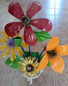 Flowers made out of plastic coke bottles.