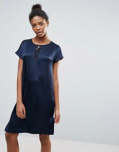 Buy it now. Vila Clean Shift Dress - Navy. Dress by Vila, Silky-feel woven fabric, Crew neck, Lace insert, Cap sleeves, Button-keyhole back, Regular fit - true to size, Machine wash, 100% Viscose, Our model wears a UK S/EU S/US XS and is 179cm/5'10.5 tall. Seeking inspiration from street and city style, Danish label Vila combine quality fabrics, textures and delicate cuts to create fashion-forward garments. Intricate feminine detailing and fine prints channel the brand's signature elegant…