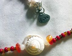 """#waistbeads Love Me Strong - Single strand: Carnelian, Rose Quartz and Sea Shell & """"Love"""" charm. #keffigal #rootsnculture $22.50"""
