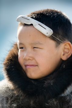 Inuit bone eyewear protecting chi,d against sun blindness....... from Kylephoto.com