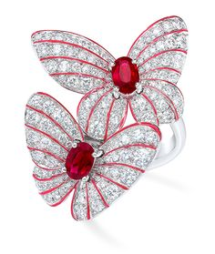 Cellini Jewelers Butterfly ring with Rubies and Diamonds  This gorgeous pave two butterfly ring features 0.95 carats of oval cut rubies and 1.70 carats of round brilliant diamonds. The delicacy and vibrancy of the butterfly is further enhanced with hand painted iridescent red enamel. Set in 18 karat white gold