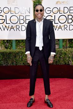 "Forget about Tom Ford, recording artist Wiz Khalifa rocked a Thom Browne suit the Golden Globes. The 22-year-old, who is nominated for Best Original Song for ""See You Again"" from Furious 7 clearly had a lot to smile about on the red carpet."