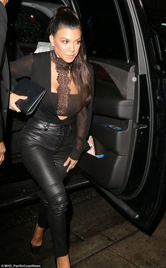 Sheer beauty! The reality star covered her stylish crop top with a long-sleeved, see-through black top, which she tucked into her skintight, black leather trousers