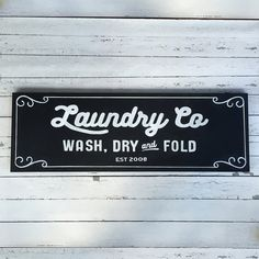 "Bring style and charm to your laundry room with a laundry sign inspired by Joanna Gaines of "" Fixer Upper ."" Customize the sign with your EST year for a thoughtful wedding or anniversary gift. ::::: Details :::::  12"" x 36"" Hand painted with a black background and white lettering. Includes two hangers on back. Be sure to mention the year you want in the ""Notes to Seller"" portion of the checkout process. Please allow a two-week turnaround time."