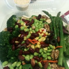 Lunch!  Spinach with carrots, asparagus, mushroom, broccoli, corn and celery topped with sesame-crusted tofu, edamame and kidney beans and finished off with cranberries, walnuts and almonds. Served with a side of hummus.