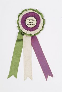 A Suffrage Badge and Ribbon produced for the English group the Women's Social and Political Union. Suffragette Jewellery, Suffragette Colours, Deeds Not Words, Suffrage Movement, London Museums, Thinking Day, Women In History, Ladies Day, Rosettes
