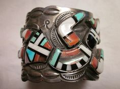 This magnificent Zuni cuff is adorned with jet, turquoise, abalone, and more! The Dancing Figure is costumed in traditional array and set in…