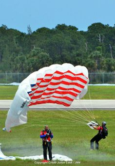 Great Photo of the Lucas Oil Skydivers performing at the Vero Beach Air Show 2014! Thank you Julian Leek!
