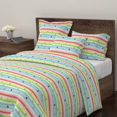 Wyandotte Duvet Cover featuring Rainbow Tropical Buggles  - LARGE by drapestudio | Roostery Home Decor