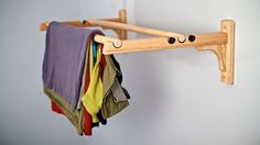 NeverFold: Time Saving Closet Solution by NeverFold. NeverFold is a time-saving closet solution composed of two adjustable rods that allows you to drape clothing rather than folding. Giving you no wrinkles and more closet space.