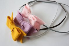 wool felt bow baby headband-these are so cute and simple. I think the big bows are just too much.