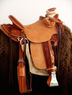 Keith Valley vaquero half-breed wade saddle with exposed tooled stirrup leathers on rough out fender - very cool!
