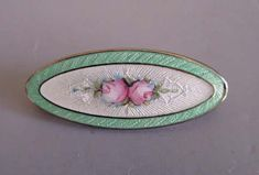 ENAMEL on sterling oval brooch with pastel green border, pink roses motif, circa 1920 Victorian Jewelry, Antique Jewelry, Vintage Jewelry, Sterling Jewelry, Enamel Jewelry, Different Flowers, Rose Earrings, Leaf Shapes, Flower Brooch