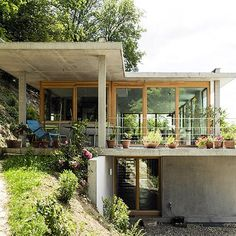 at germany's southern most tip architect gian salis has built a two storey home on an inclined site surrounded by wildlife via designboom-nature, home, peace