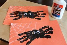 Adorable Halloween handprint art project. Spiders! Cute craft for preschool and kindergarten.