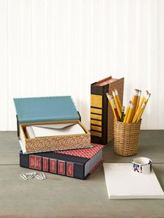 I'm not sure if I could bring myself to deface a book...but if I could I'd do this! Book Storage Boxes