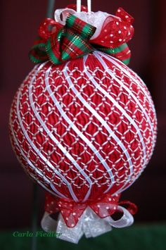 "St. Anne Quilting and Sewing: Smocked Christmas Ornaments - 1/8"" ribbon is woven through stitches; other ideas for embellishing smocked ornaments"