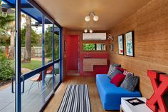 Compact 250 square foot guest house made from a shipping container. Not only is this a really great looking space, it has lot of green features as well, including grey water recycling and a green roof.