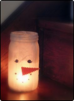 painting any small jar white, adding the little orange nose by using glue dots perhaps(?) then drawing on the eyes & mouth - cute!