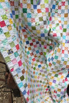 "My postage stamp quilt is a finish and I'm so excited about it!    Doesn't it just shout ""Spring""!     I made the blocks as leader/enders ..."