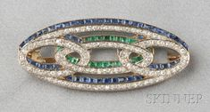 Art Deco Platinum, 18kt Gold, Diamond, and Gem-set Brooch, France, set with calibre-cut sapphires and emeralds, and old single- and old mine-cut diamonds, engraved gallery, lg. 1 3/4 in., no. 23753, maker's mark and guarantee stamps.