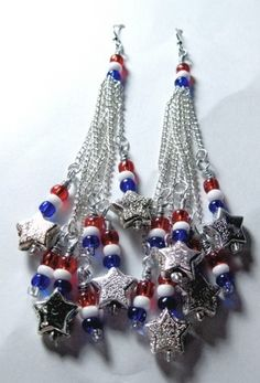 """""""Fireworks"""" - a set of earrings created by Lanine M. for the Artbeads Red, White and Blue contest. These earrings definitely have the patriotic sparkle of fireworks bursting in the air! Learn more about this contest here: http://www.artbeads.com/swarovski-artbeads-contests.html"""
