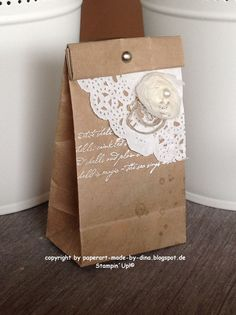 Beautiful, quick, and easy gift packaging. Kraft paper bag, paper doily, and ribbon flower.