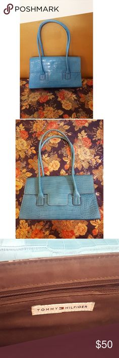 Baby Blue Tommy Hilfiger Purse Baby Blue Tommy Hilfiger Purse,  In excellent condition. Inner Lining Excellent. Bottom, Excellent.   This item may have been worn but has no visible signs of wear. Tommy Hilfiger Bags