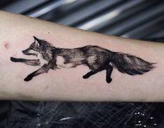 Running fox tattoo on forearm.