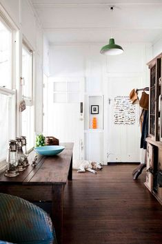 love the green light with the white walls and dark wood