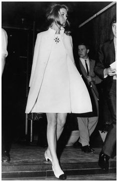 British fashion model Jean Shrimpton in a matching white knee-length dress and coat, Australia, 1965. (Photo by Keystone/Hulton Archive/Getty Images)