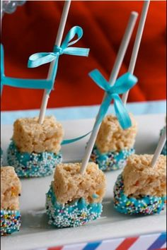 Rice Krispies dipped in blue choc and on a cake pop stick