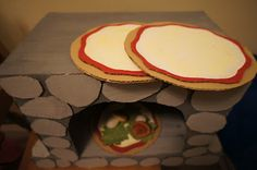 """interactive imaginary play cardboard fireplace and cardboard food to """"cook"""""""