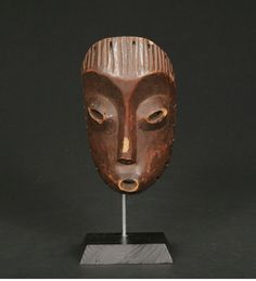 """A fine and rare Lega face mask, D.R. Congo; The mask with simple features, the face deeply concave with raised eyes and mouth. Stylized coif at top. Fine old patina.  Ex. Lawson Mooney, Director of Catholic Aid Agencies Zaire,   Ken Adelman, Director of USAID Zaire, and former US Deputy ambassador to the UN.  David Gelbard collection, NY  H: 9"""""""