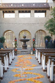 every last detail | wedding inspiration | ceremony | aisle | flower petals | fountain | altar | spanish inspired wedding