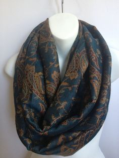 This beautiful infinity scarf in stunning color add the perfect finishing to any outfit. This is A MUST-TO-HAVE for everyone. This lovely loop scarf