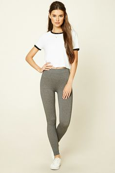 A pair of heathered knit leggings featuring an elasticized waist.