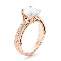 #102777 This exquisite engagement ring features a round diamond prong set in rose gold, with custom hand engraving on the band, hand-made filigree, and several round morganite...