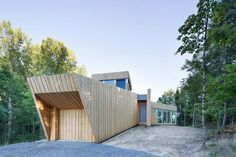 Modern single story lake house that flows across the land