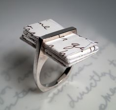 Stunning and very dope idea i would totally write my shopping list and stick it in this ring ha ha