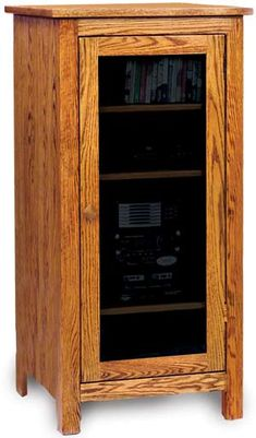 Amish Mission Stereo Cabinet with Four Adjustable Shelves Stylish solid wood storage for your living room or family room. Choice of wood or glass door. Pick from a variety of wood types and stain colors. All Wood Furniture, Media Furniture, Amish Furniture, Home Furniture, Furniture Design, Stereo Cabinet, Cabinet Dimensions, Wood Cabinets, Media Cabinets