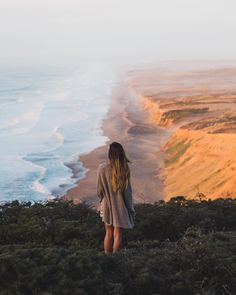 """""""Standing before it all. I took this shot of my girlfriend as she stood on the edge of a cliff facing the shore of Point Reyes CA. The sunset lit the scene so perfectly. Definitely a place I recommend going!"""" @kylehouck  Canon 6D 