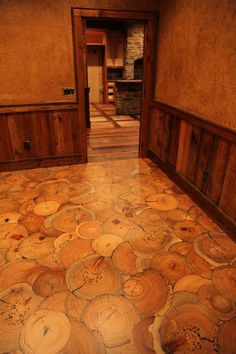 Fantastic end-grain wood floor with slices of a tree trunk.
