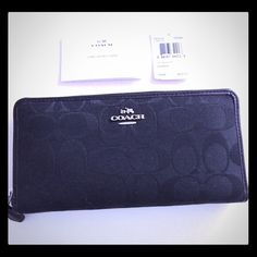 """SALECOACH Signature Accordion Zip Wallet(black This is a BRAND NEW, guaranteed authentic COACH Accordion Zip Wallet, purchased directly from Coach! This is a real beauty of a wallet and particularly durable for extended use! The black on black color is BEYOND gorgeous with Coach's signature """" C"""" pattern! Wallet opens to reveal 2 full-length bill compartments, 12 credit-card pockets, zip coin pocket and extra multifunction pocket. 7 1/2"""" (L) x 4"""" (H) x 1"""" (W). No bundle during blowout sale…"""