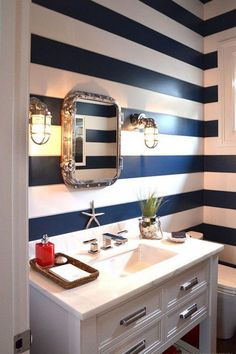 See 25 gorgeous beach house interior  inspirations: Nautical powder room stripes